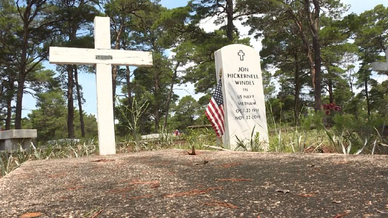 A couple grave markers dot the grounds of the Historic Gulf Cemetery in Santa Rosa Beach.