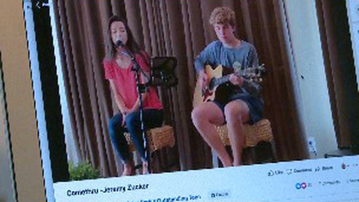 Two high schools are performing a song to post to social media and put a smile on people's...
