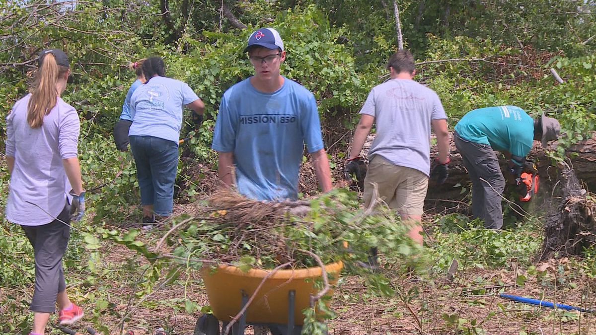 Teens from Alabama and Massachusetts cleaned up a Springfield woman's yard Saturday with...