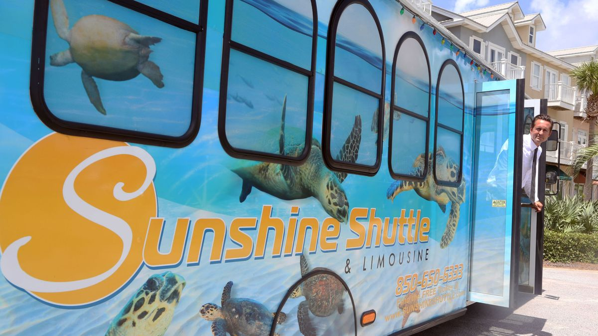 MICHAEL SNYDER   Daily News<br />Sunshine Shuttle's John Finch poses with the company's tortoise painted trolley as it stops in Gulf Place Thursday, July 28, 2016.