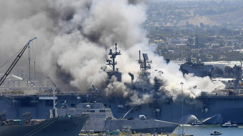 FILE - In this July 12, 2020, file photo, smoke rises from the USS Bonhomme Richard at Naval...