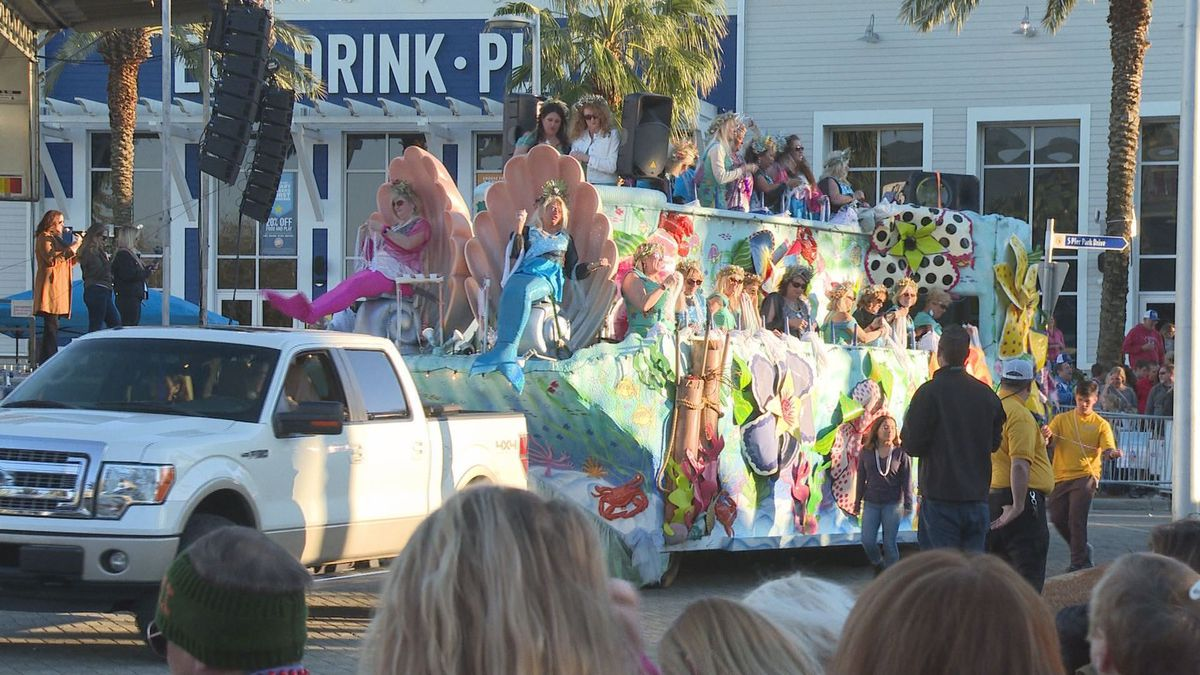 Thousands caught beads, wore costumes and more at the Mardi Gras and Music Festival. (WJHG/WECP)
