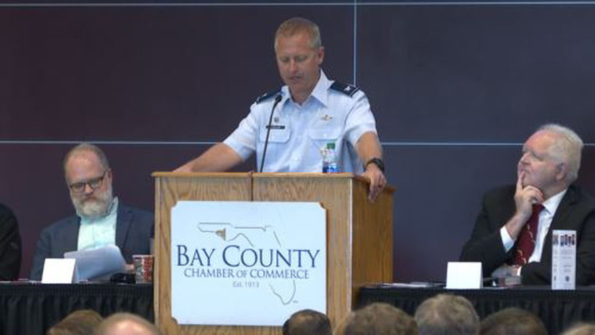 Commander Brian Laidlaw gives a presentation on the state of Tyndall Air Force Base repairs. (WJHG/WECP)