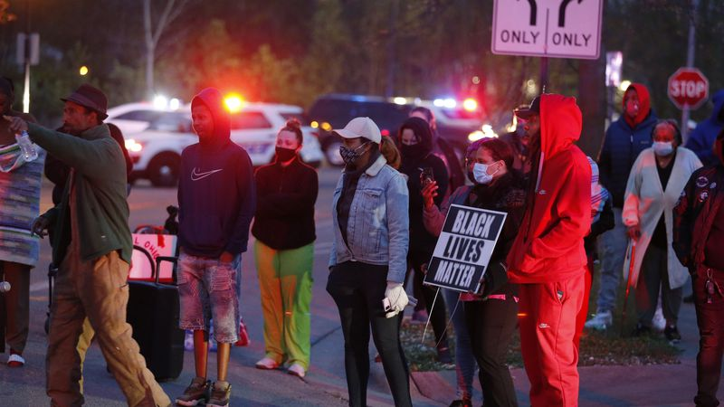 A crowd gathers to protest in the neighborhood where a Columbus police officer fatally shot a...