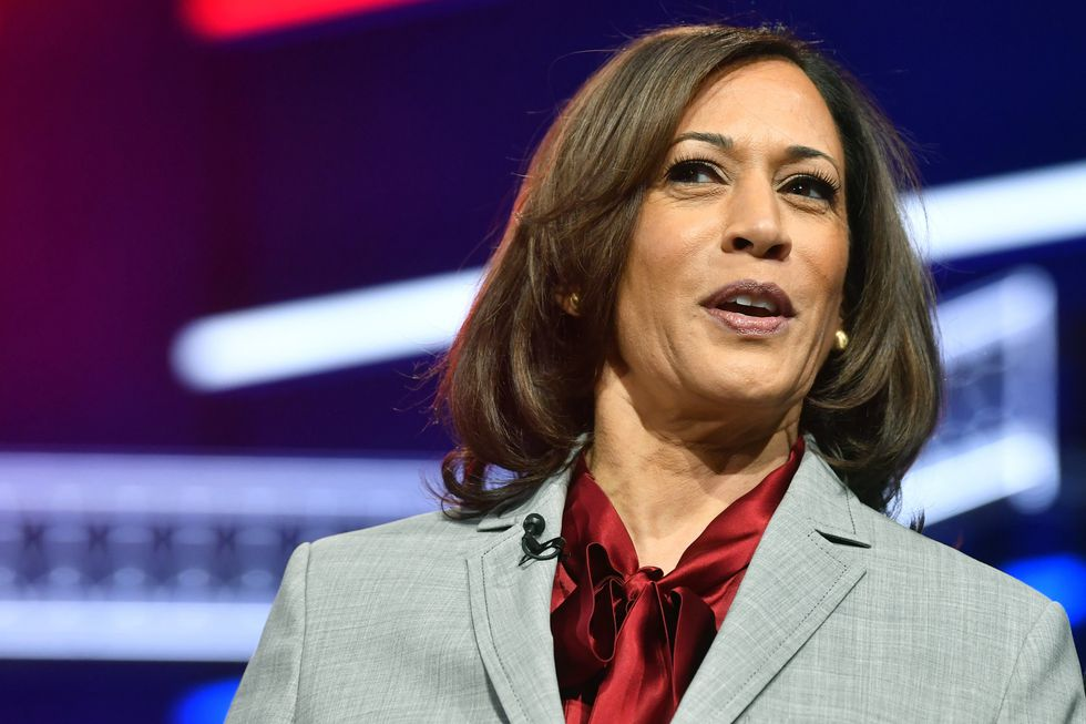 Sen. Kamala Harris, D-Calif., walks onto the stage before a Democratic presidential primary debate, Wednesday, Nov. 20, 2019, in Atlanta. In one of Harris' conversations with the vetting committee, Chris Dodd — a longtime Biden friend who served alongside him in the Senate — asked if she had remorse for her debate stage attack on his busing record.