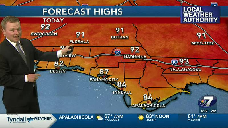 Meteorologist Ryan Michaels showing this afternoon's high temperature forecast.